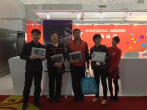 Passengers of Hong Kong Airlines Tianjin inaugural flight received souvenirs before boarding