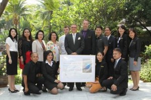 Andre Brulhart (6th left), general manager of Centara Grand at Central Plaza Ladprao Bangkok, together with the green team celebrates the EarthCheck 2014 Silver Certification award at the hotel's garden.