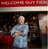 Guy Fieri welcomes guests on opening day of Guy Fieri's Vegas Kitchen & Bar at The Quad Resort & Casino on Thursday, April 17, 2014.