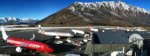 Full house... Aircraft from Virgin Group airline Polynesian Blue, Jetstar, Air New Zealand and Qantas parked side by side at the increasingly busy Queenstown Airport, late last month.