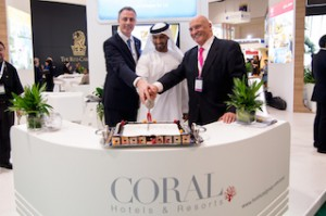 Coral Hotels & Resorts gets a new corporate identity. Celebrating its success here are H.E. Sheikh Mohammed bin Faisal Al Qassimi, Chairman, HMH - Hospitality Management Holdings, Michel Noblet, President, HMH and Laurent A. Voiv