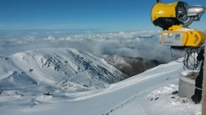 New Zealand - Mt Hutt snow gun at the ready looking down towards the base building with the Canterbury Plains in the background_media