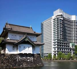 The Imperial Palace's Tatsumi watchtower shares a moat with the Palace Hotel Tokyo