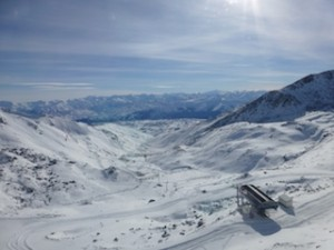 The stunning view of The Remarkables ski area from Curvey Basin looking down to the valley below_media