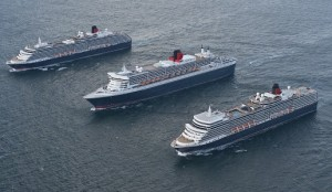 Cunard's magnificent Queens line up three abreast for the first time in dramatic photoshoot as fleet sails from Lisbon to Southampton to mark flagship Queen Mary 2's 10th anniversary