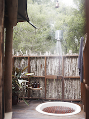 Outdoor hot shower at Paperbark Camp - image1