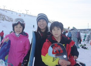 Queenstown locals (L-R) Cool, Yuko and Anru Wakushima enjoying opening day