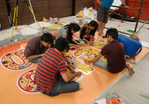 Artists in Mumbai creating the Rangoli