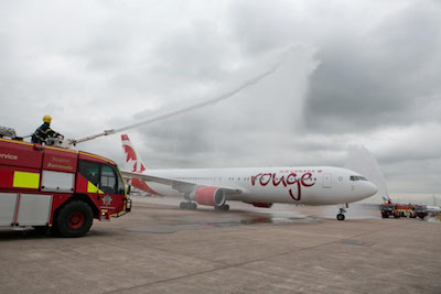 AIR CANADA ROUGE - Air Canada rouge welcomes customers onboard