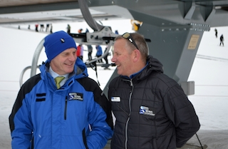 Bill English (L) and The Remarkables ski area manager Ross chat before getting on the new Curvey Basin chairlift