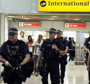 British police with submachineguns on patrol at Heathrow Airport