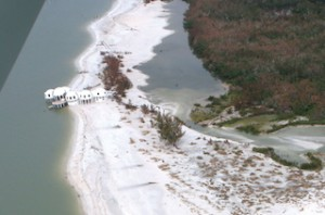 AFTER Hurricane Andrew in 1992 washed part of the beach away, leaving the    house on land and in sea. (Rookery Bay National Estuarine Research Reserve)