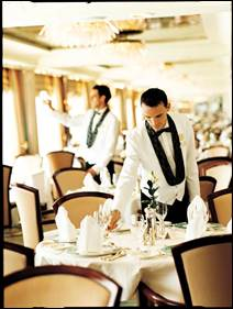 Waiters prepare the Crystal Dining Room for guests