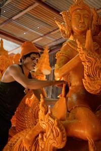 Local artisan of Ubon Ratchathani carefully carves the candle for the province's most celebrated festival.