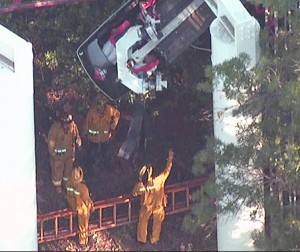 Firefighters survey what appeared t ... on the Ninja ride. Credit KTLA