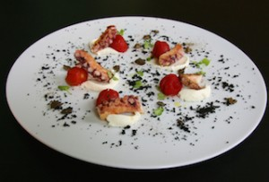Browned octopus, baked tomatoes, robiola soft cheese, dried olives and capers powder l