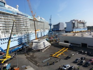 First Look at Quantum of the Seas which came out of Meyer Werft Shipyard in Papenburg, Germany yesterday. In the foreground is her funnel, waiting to be installed on the top of the ship
