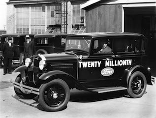 HENRY Ford at the wheel of his twenty millionth vehicle, a Model A in April 1931. It    is now on display at the Henry Ford Museum at Dearborn, Michigan. (Henry Ford    Museum)