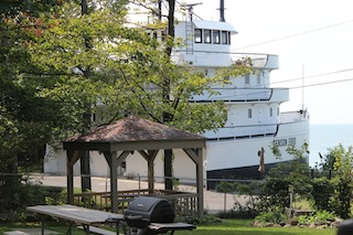 FROM ashore you can see how the complete forecastle was cut off and relocated.    (Jerry Kasper)