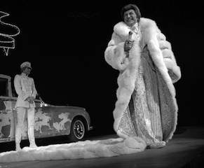 ON stage in that $300,000 virgin fox coat: with its near-5m train, it weighed 45kg.