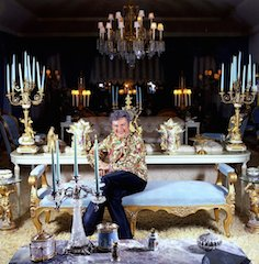 LIBERACE amongst the opulence of his totally over-the-top sitting-room.