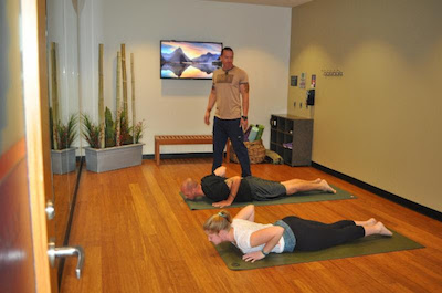 Yoga practitioners  Corey Kelly, Michael Sokolowske and Coleen Taylor make use of the Midway Yoga Room