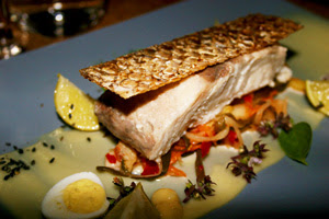 Solar Comfit Sea bass, air dried crispy skin, ground fermented kimchee, preserved lemons, sesame mayonnaise.