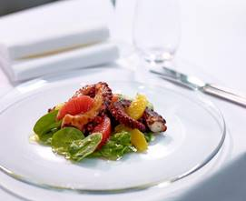 'Grigliata de polpo con spinaci in balsamico e olio di olive', grilled Mediterranean octopus with citrus salad on a bed of baby spinach leaves.