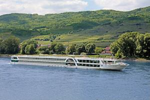 River cruise vessel Amadeus Brilliant on the Danube River passing through the Austrian Valley Wachau.