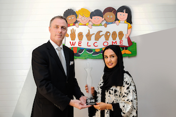 HMH CEO Laurent A. Voivenel Presents Award toMrs Bedour Saeed Al Raqbani, Director and Founder of Kalimati - 2