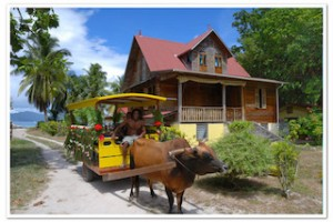 Oxcart and colonial house on La Digue © Gerard Larose:STB