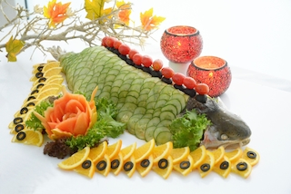 Whole poached salmon with condiments