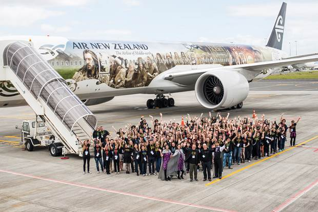 The Hobbit Fan Fellowship, with Air New Zealand Chief Executive Officer Christopher Luxon and Tourism New Zealand Chief Executive Kevin Bowler, in front of Air New Zealand's Hobbit inspired Boeing 777-300ER.