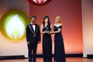 Photo16_Ms. Poman Lo receiving her award for 'The Ten Outstanding Young Persons of the World' at the ceremony in Germany