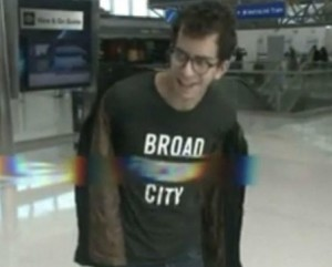 Student in T-shirt with offending word pixellated out