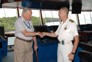 Anzac Veteran Thomas Iser tours the bridge with Sun Princess Captain Lorenzo Paoletti