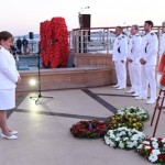 Queen Elizabeth Captain  Inger Klein Thorhauge pays her respects at the Anzac dawn service onboard the ship at Gallipoli