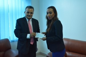 His Excellency  Mr. Dhananjay Jha, Ambassador of Nepal to the UAE receives cheque from Arabian Courtyard Hotel And Spa