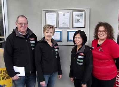 (L-R) Peter and Cathy Coppens with members of the Queenstown Lakeview Holiday Park team
