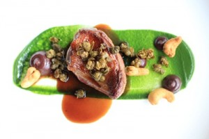 Mieral pigeon with spinach , boudin noir and spiced cashew nuts