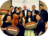 Mike_back_row_3rd_fm_right_and_Alice_front_1st_right_with_the_team_in_Singapore_kb