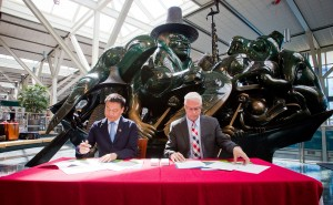 RICHMOND, B.C .: JUNE 23, 2015 -- Mr. Jing Yiming, President of Shanghai Airport Authority (SAA) and Craig Richmond, President and CEO of Vancouver Airport Authority (YVR) sign a Memorandum of Understanding on Cooperation at YVR in Richmond, British Columbia on June 23, 2015. (BEN NELMS for YVR) (CNW Group/Vancouver Airport Authority)