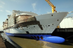 June 2015 - The newest member of Royal Caribbean International's Oasis class is now one step closer to full completion as her April 2016 debut approaches. With the exterior complete, Harmony of the Seas was floated out of her dry dock to begin the next phase of interior construction. (PRNewsFoto/Royal Caribbean International)