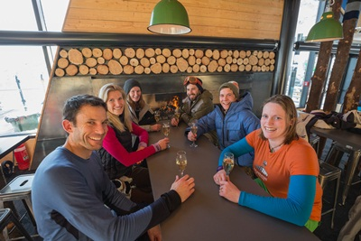 Bubbles and smiles all round in the lounge area of The Remarkables base building (L-R) Marcus Kirk, Samantha Kirk, Jen Middleton, Blair Matheson, Stu Minty and Avril Guihen