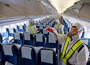 Health workers disinfect a Korean Air Lines plane at Incheon International Airport in South Korea