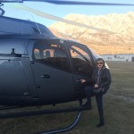 Louisa Patterson proudly stands in front of Over The Top's new Airbus H130 T2