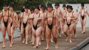 Revellers dressed in mankinis and top hats