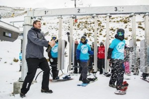 Ski area manager Ross Copland pops the celebratory bubbles at Coronet Peak_media