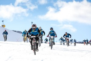 Mikey Northcott leading the pack to take 3rd at the Otterbox Mountain Bikes on Snow up Coronet Peak during the American Express Queenstown Winter Festival 2014.