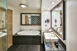 A suite room incorporates a sunken bath and range of Molton Brown products_media